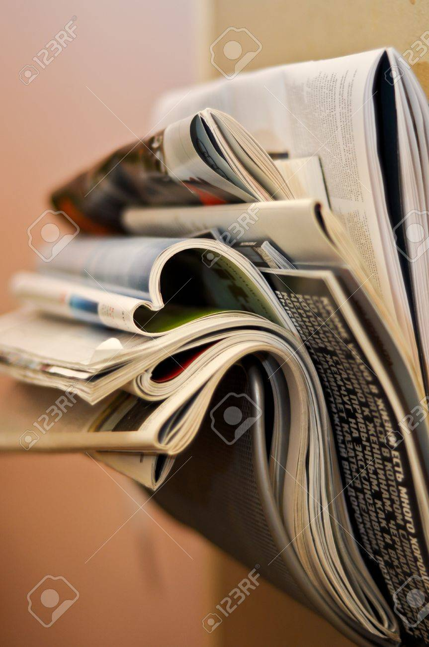 folded and crumpled newspapers and magazines in the wall bracket Stock Photo - 9228650