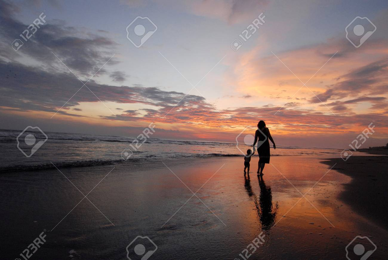 The mother with daughter on the beach. - 4130366