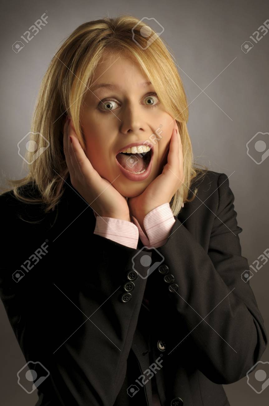 The shouting beautiful woman in black jacket on gray background Stock Photo - 6362192