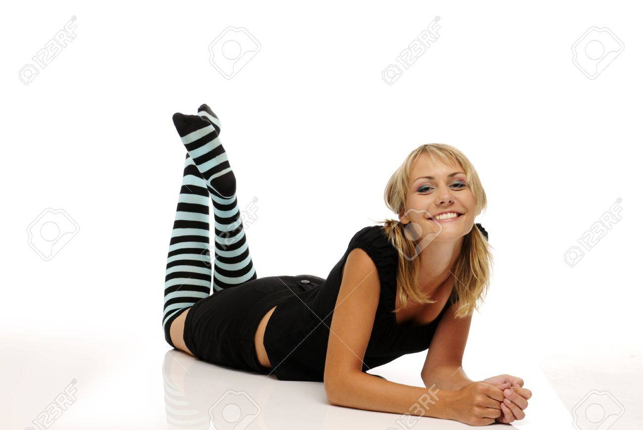 The beautiful smiling young blonde woman with stripy socks on white background Stock Photo - 7646992
