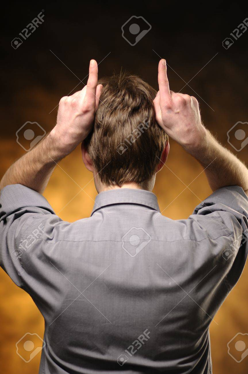 Man from behind with his hands imitate corners Stock Photo - 11012560