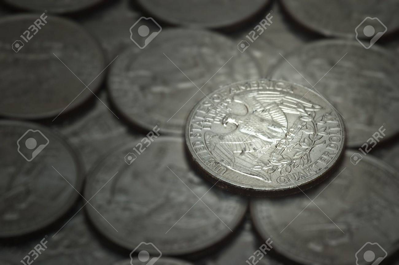 An big, attractive, shiny quarter glowing with riches. Image has a touch of green tones to soften the image and make it pleasing to the eye. Stock Photo - 6043128