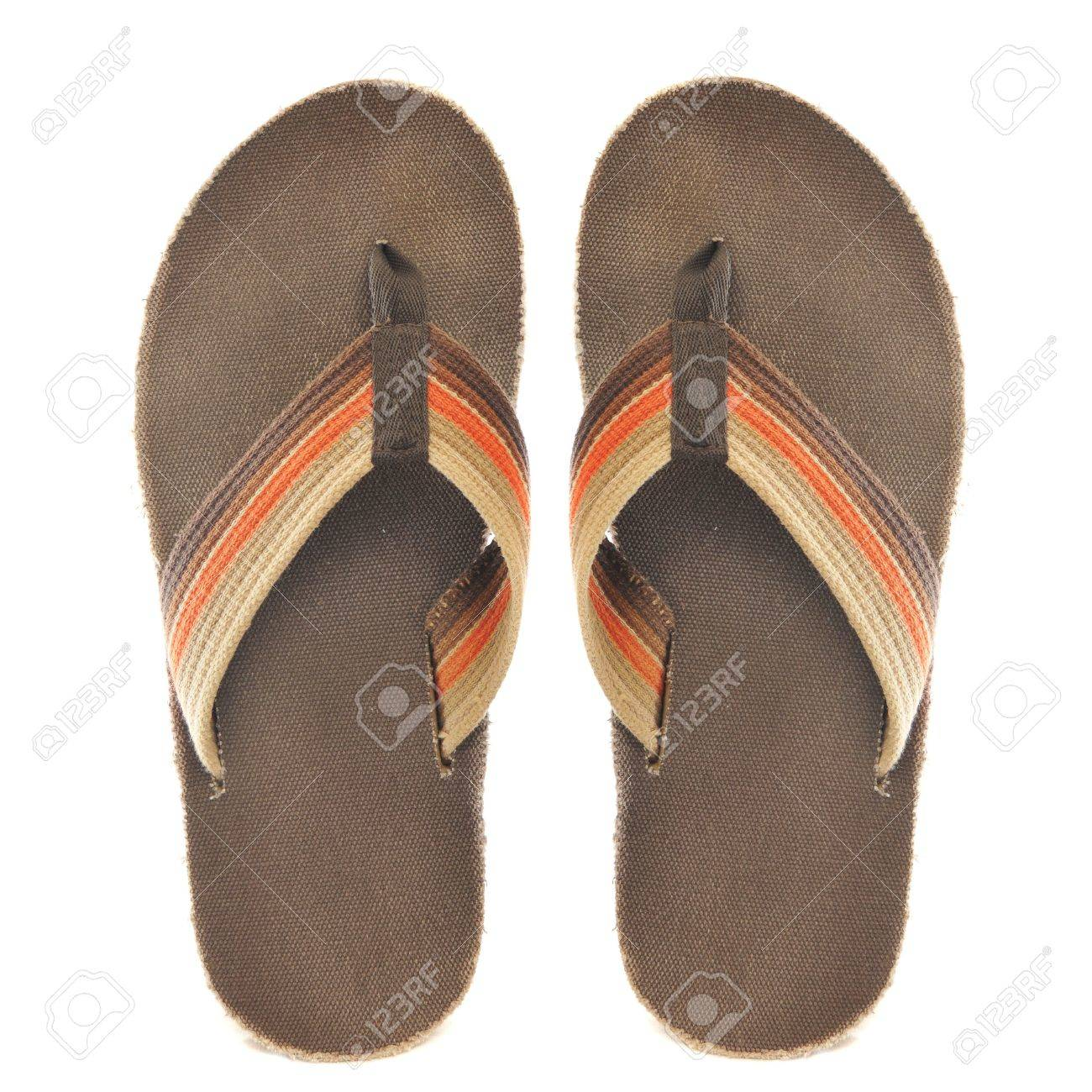 Pair of brown and orange retro oldschool junglist sandals isolated on a pure white background Stock Photo - 6200380