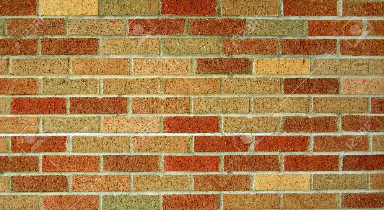 A Multicolored Brick Wall Texture Of Red Brown And Tan Bricks Stock Photo