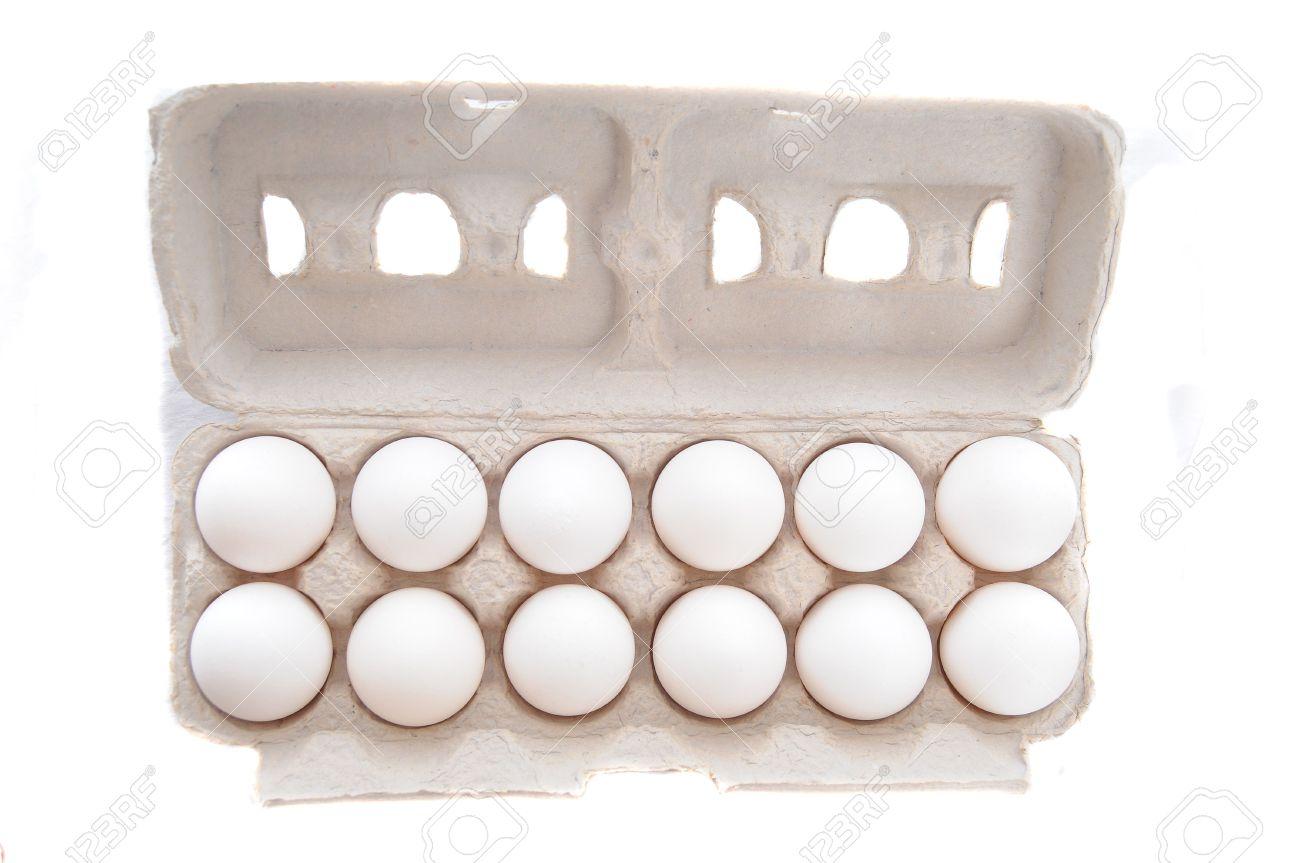 Dozen of Eggs in Egg cartion isolated on white Stock Photo - 6814000