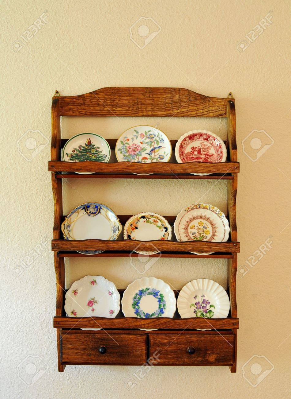 Antique Miniature Butter Pat Plates On An Old Wooden Shelf Hanging ...
