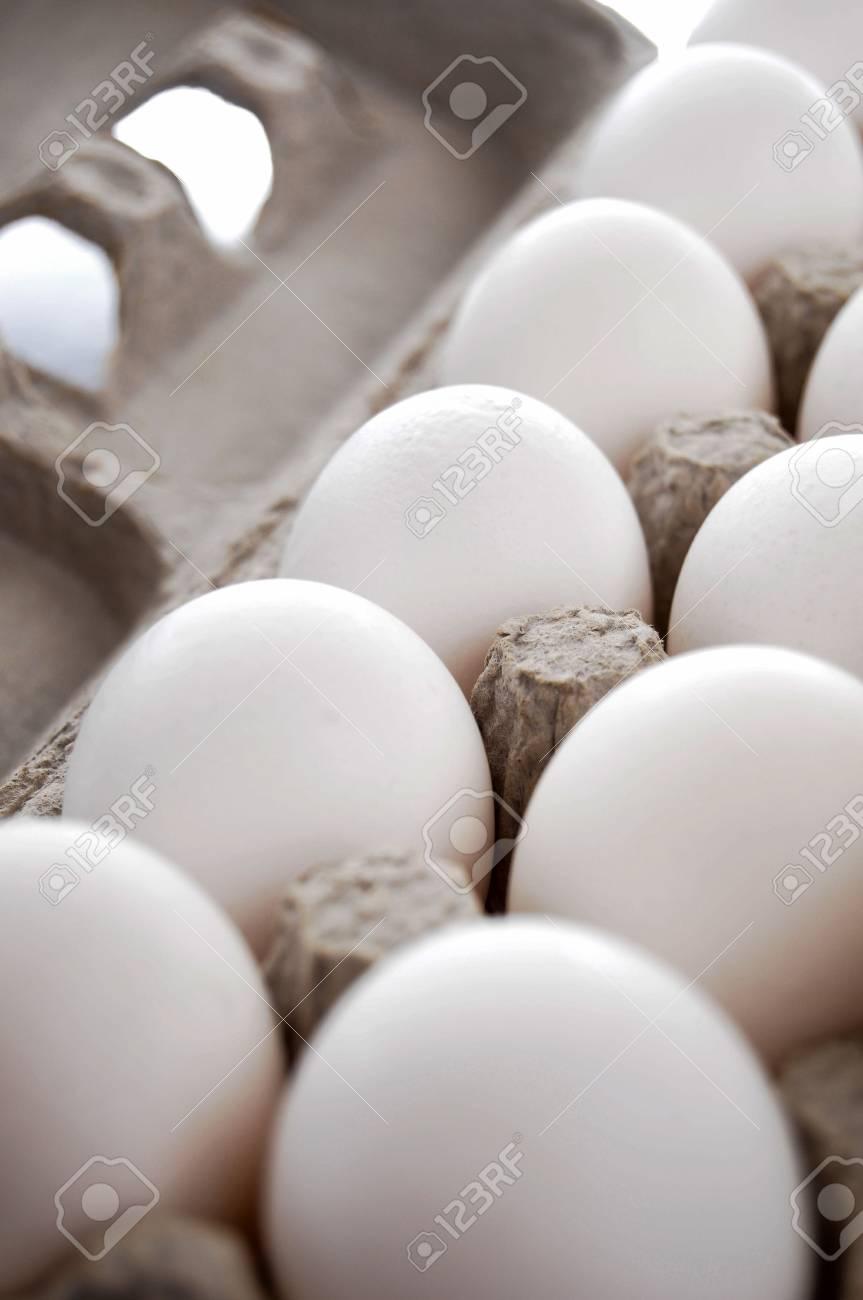 Dozen of Eggs in Egg cartion isolated on white background Stock Photo - 6814467