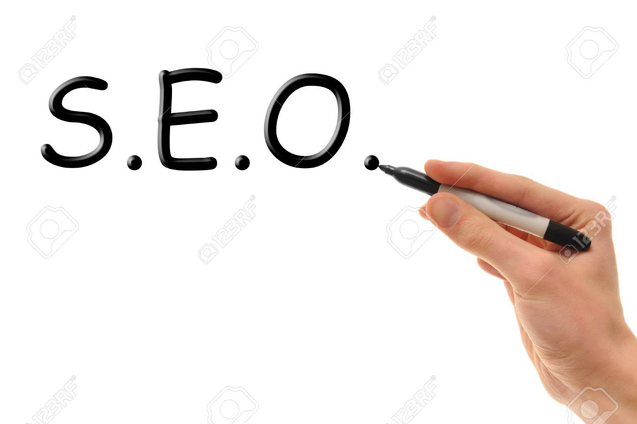 A white Caucasian hand writes the word S.E.O. on a white board with his marker. Stock Photo - 6894209