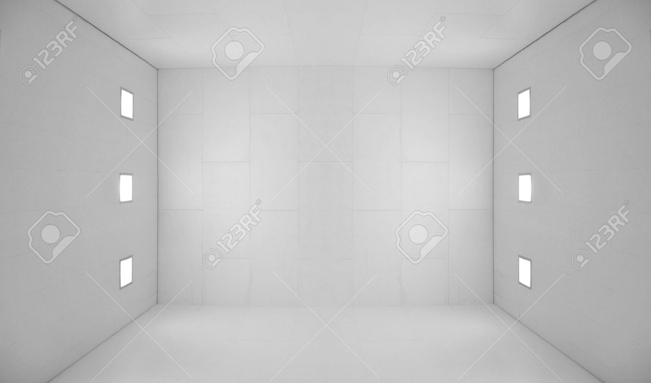 Large empty room with a wooden floor and white wooden tile walls with square lights on the ceiling and lots of open blank empty space. Stock Photo - 7216221