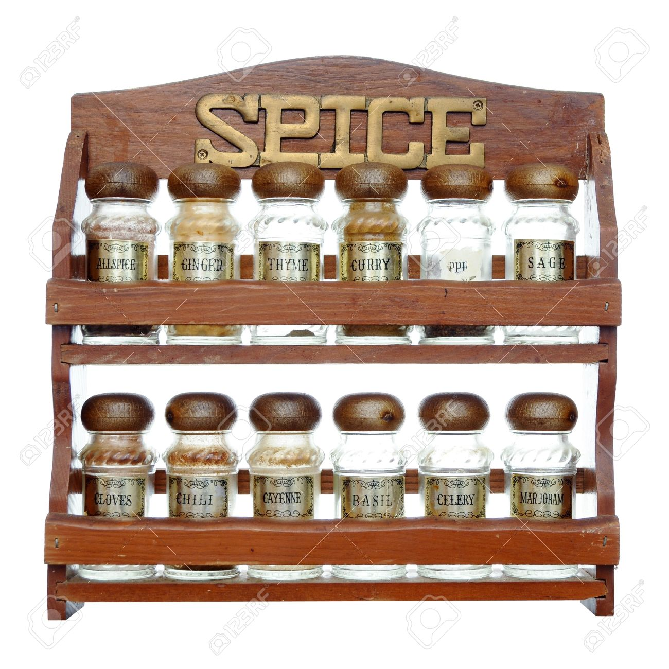 An old wooden spice rack isolated on white background most of the bottles are empty