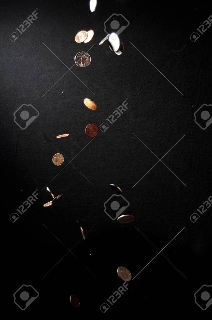 Coins falling into the darkness Stock Photo - 7618210