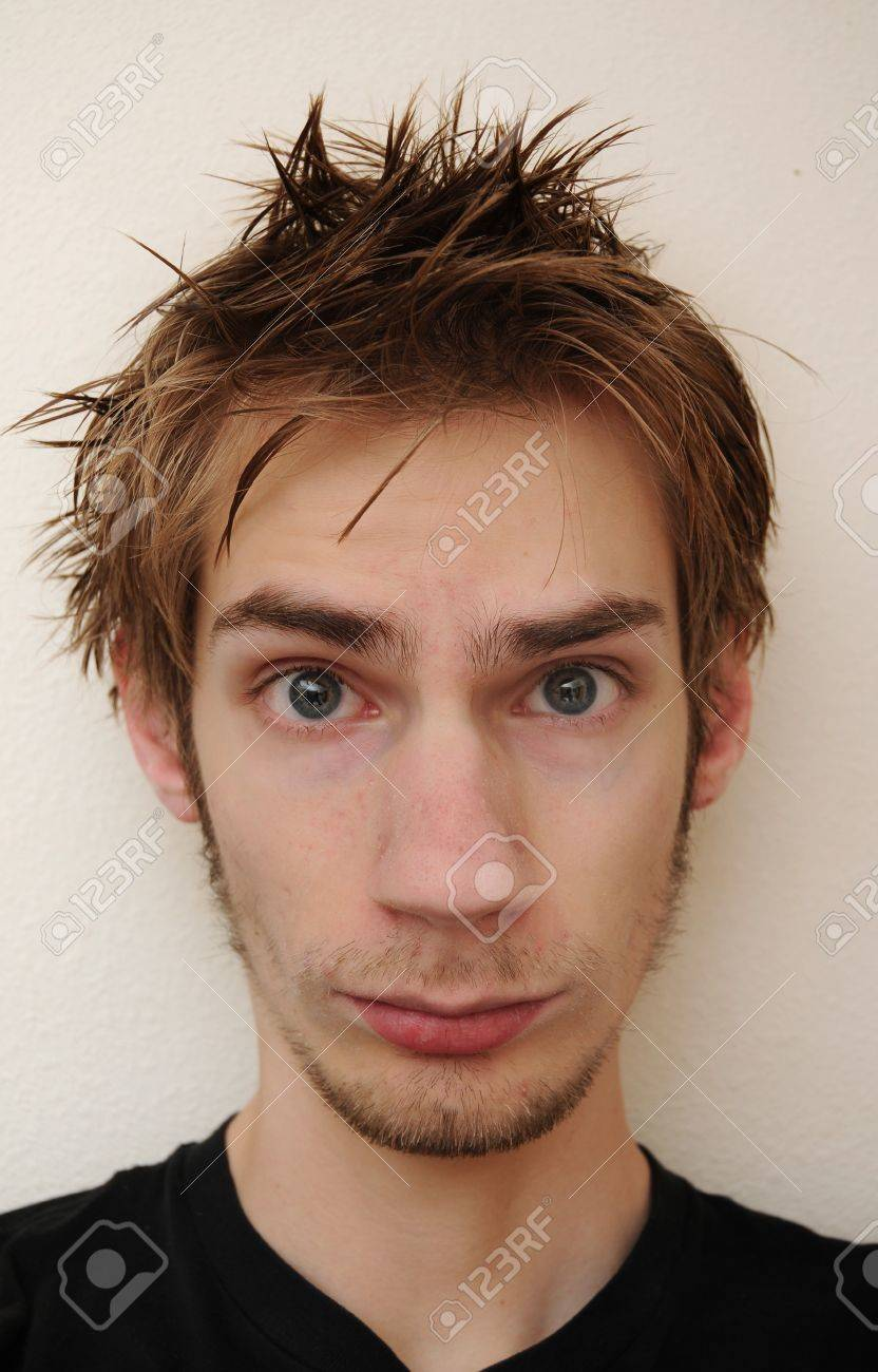 Young man with emo hair looking straight at camera. Stock Photo - 7850367