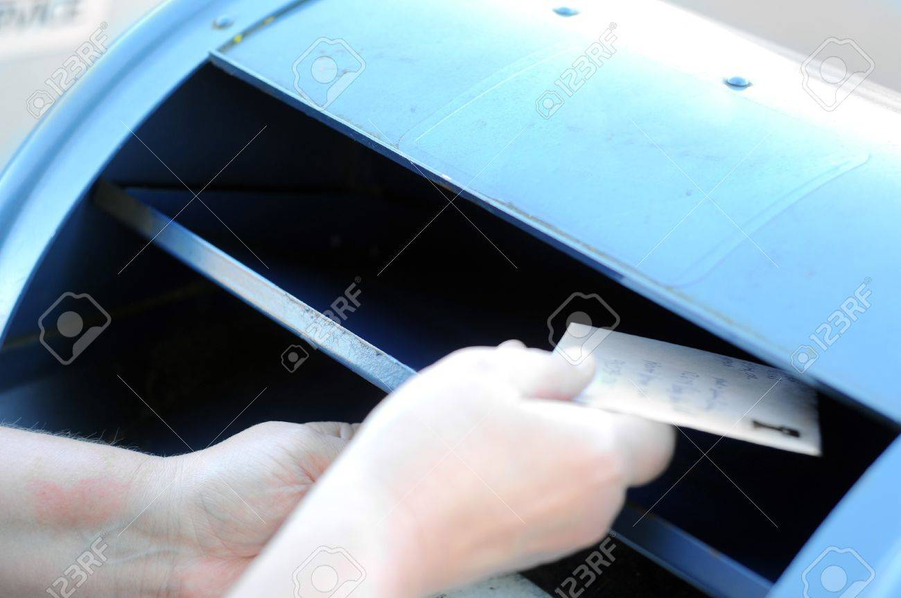 Mailing a letter in a blue public postal service dropbox Stock Photo - 8078390