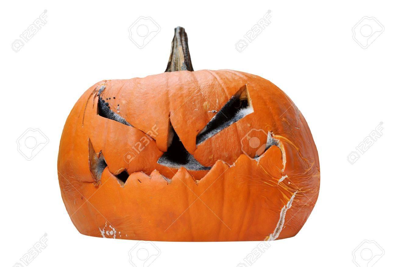 scary rotting halloween pumpkin jack o lantern unlit isolated