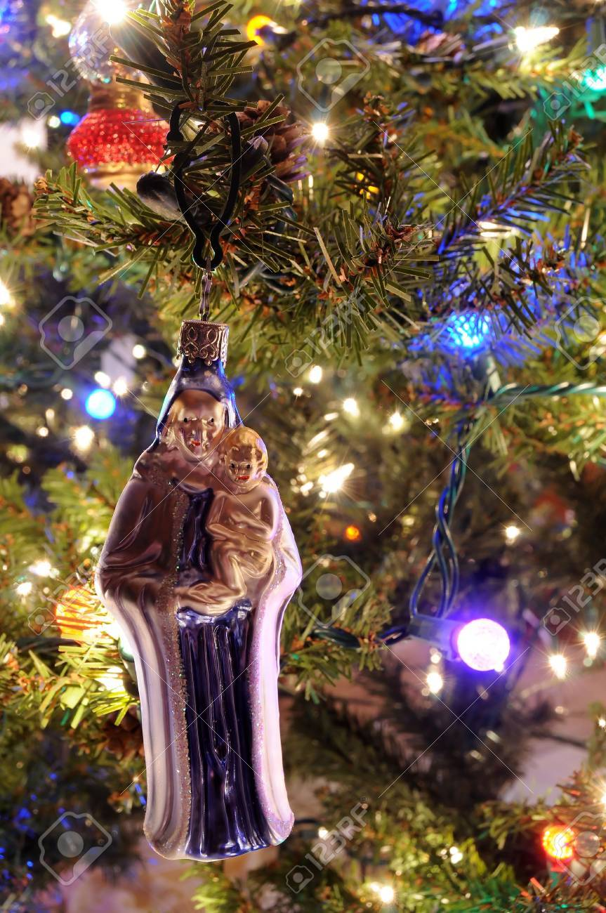 Christmas Ornament Of Mary And Jesus Hanging On A Christmas Tree ...