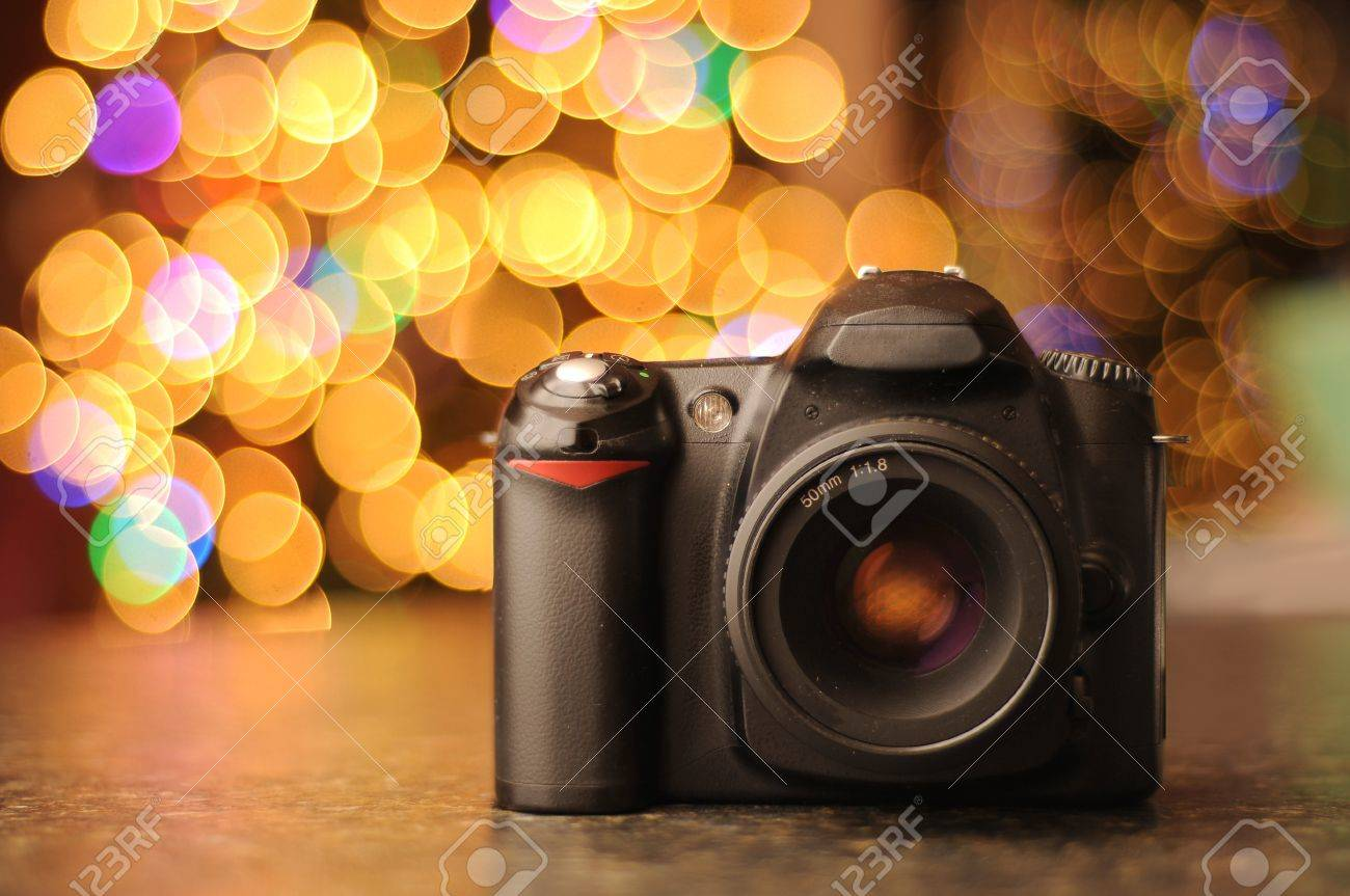 Camera Dslr Camera Effects dslr camera sitting on a black countertop with defocused bokeh background copyspace room for