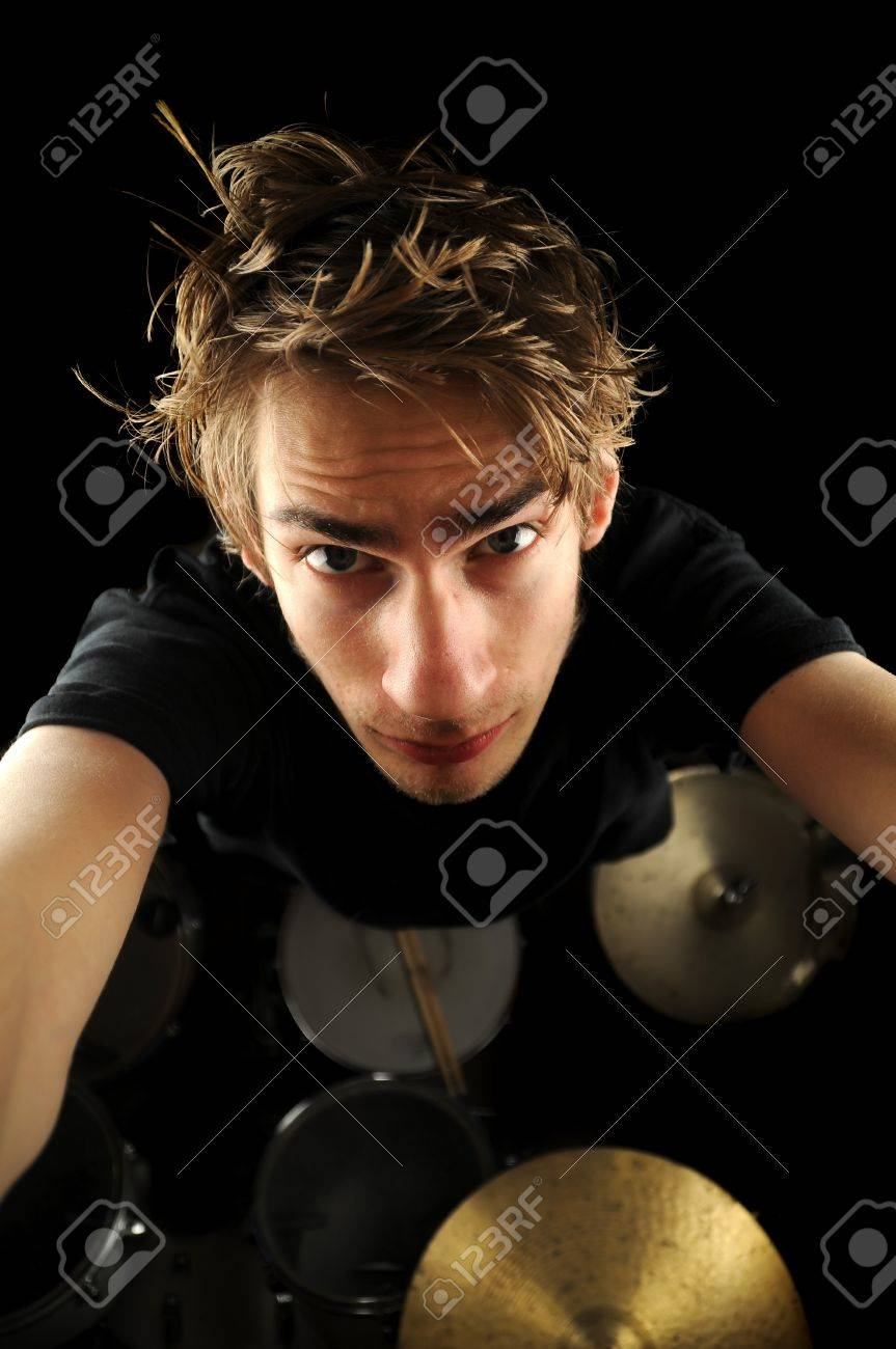 A Hot Young Drummer Guy Looking Up At The Camera With His Drum