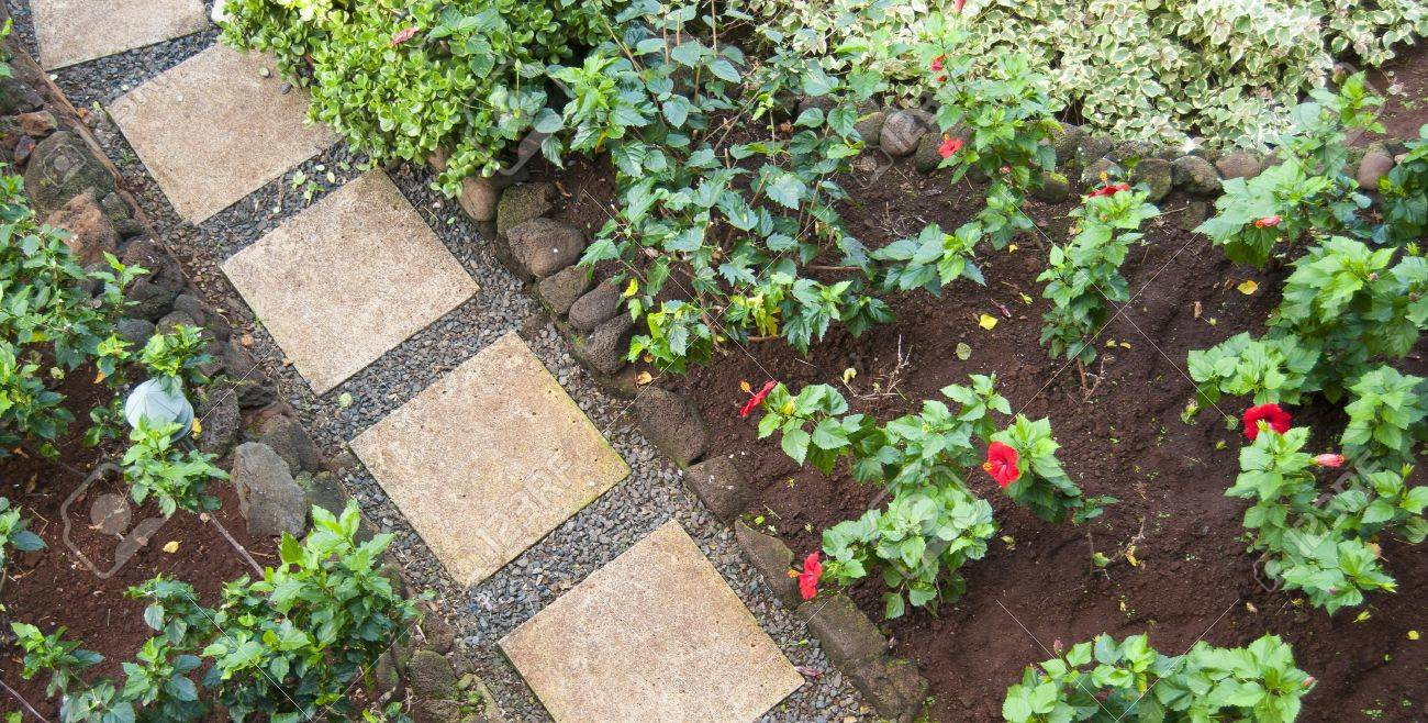 Red square pathway stones in a beautiful garden walkway stock photo red square pathway stones in a beautiful garden walkway stock photo 9014867 workwithnaturefo