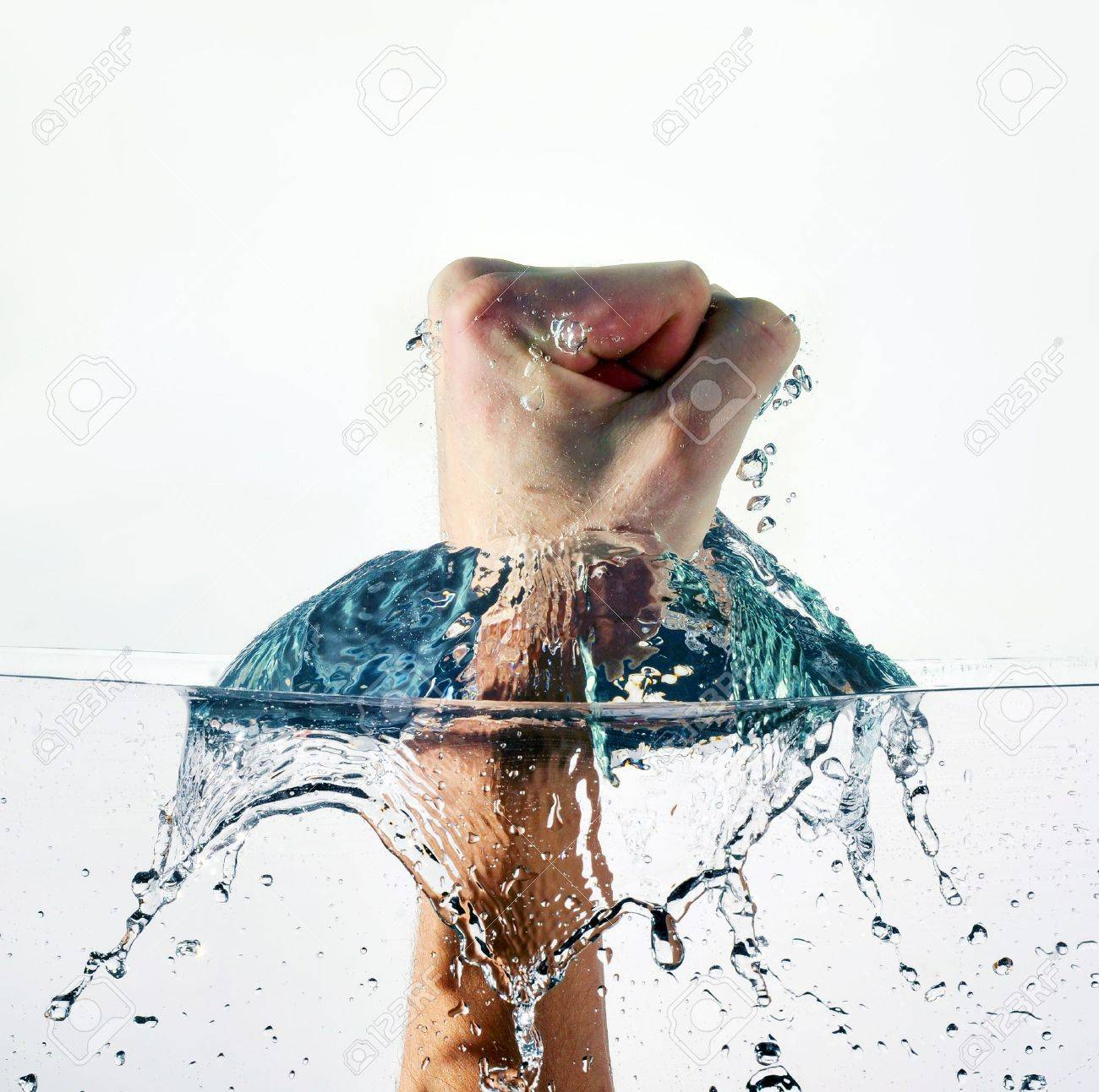 An angry fist punching water isolated on white background Stock Photo - 11838008