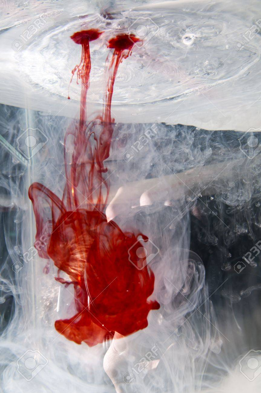Red Food Coloring Dye Being Dropped Into A Watertank Fishtank Stock ...