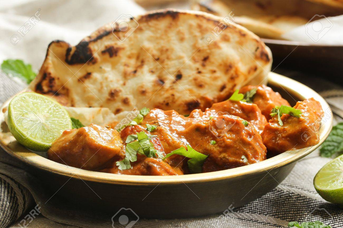 Butter Chicken Served With Homemade Indian Naan Bread Murgh Stock Photo Picture And Royalty Free Image Image 65652186