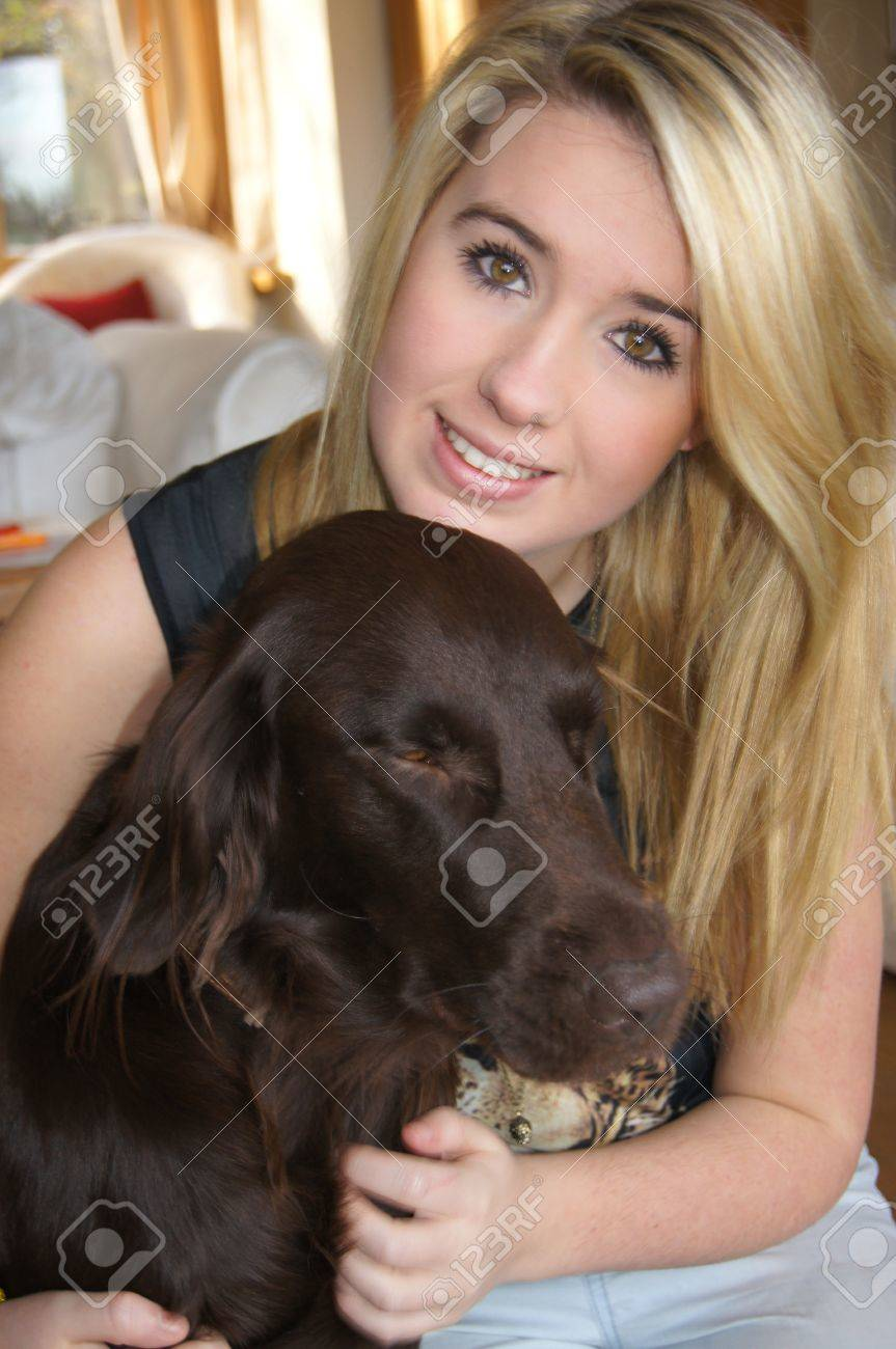 Girl Cuddling Her Pet Dog Stock Photo Picture And Royalty Free