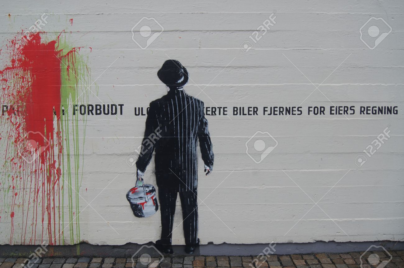 Banksy style graffiti of business man protesting against parking forbidden on public wall stock photo