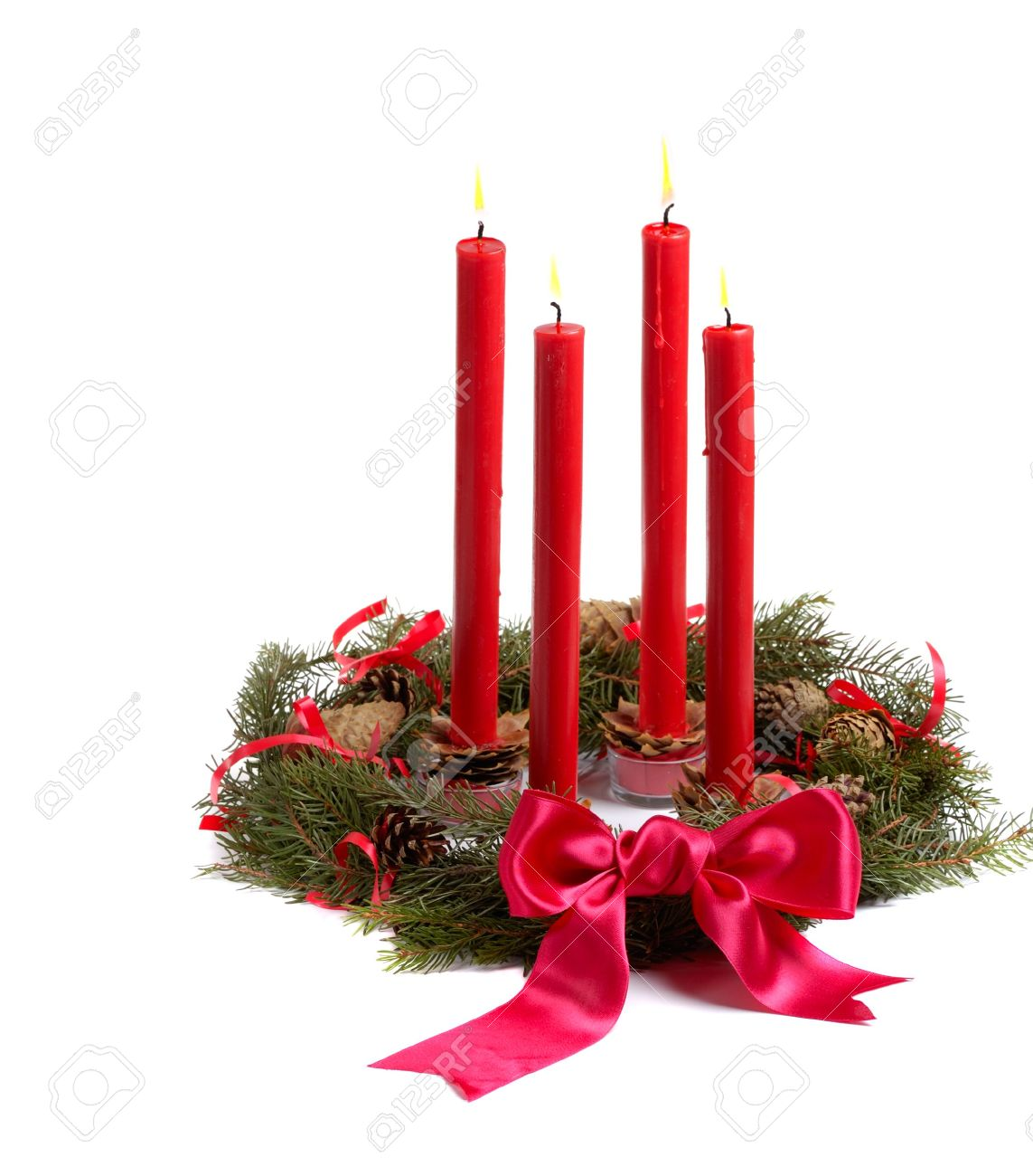 christmas wreath with red candles and pine cones isolated on