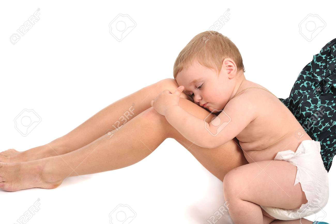 little baby nestles up to his young mother legs Stock Photo - 5246652