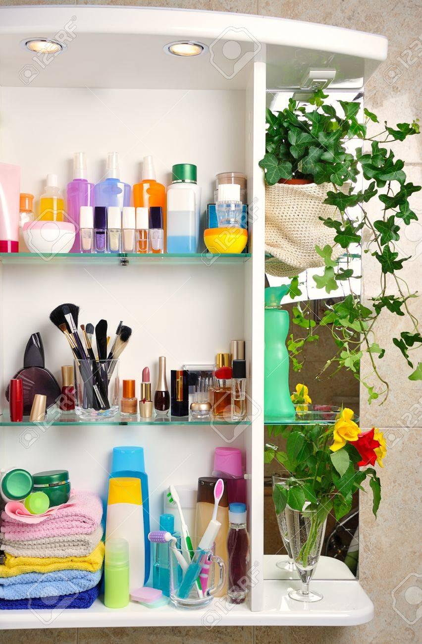 Bathroom Toiletries white bathroom shelf with cosmetics and toiletries stock photo