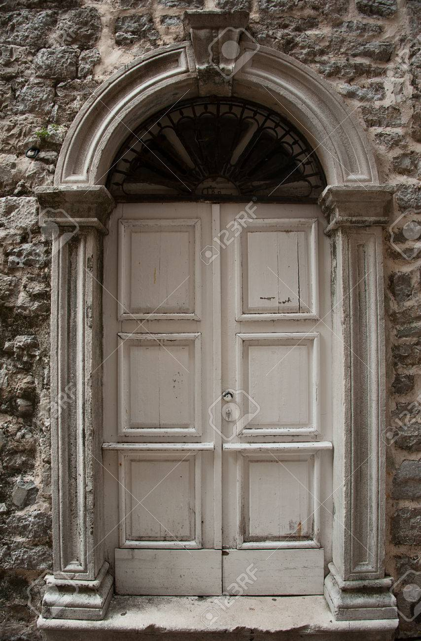Stock Photo - wooden old door with stone door aperture into stone ancient buiding & Wooden Old Door With Stone Door Aperture Into Stone Ancient Buiding ...