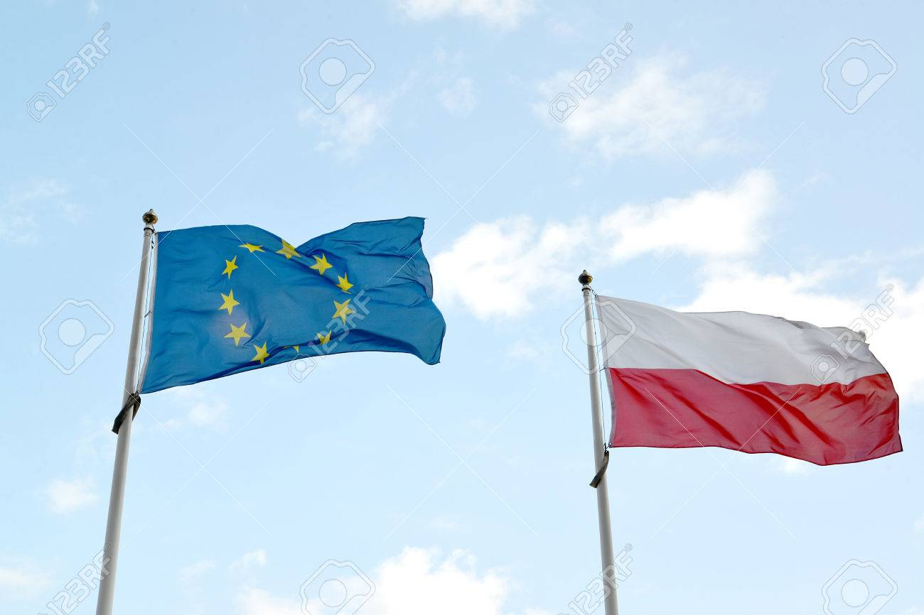 national flag of poland and flag of the european union flutter