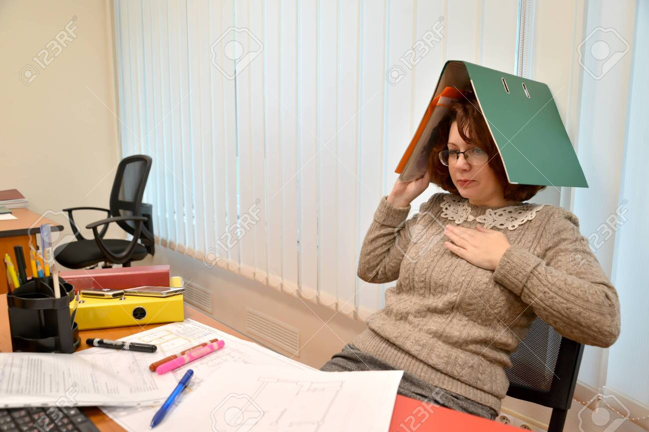 Female manager with document folder on head holding hand to heart - 130272959