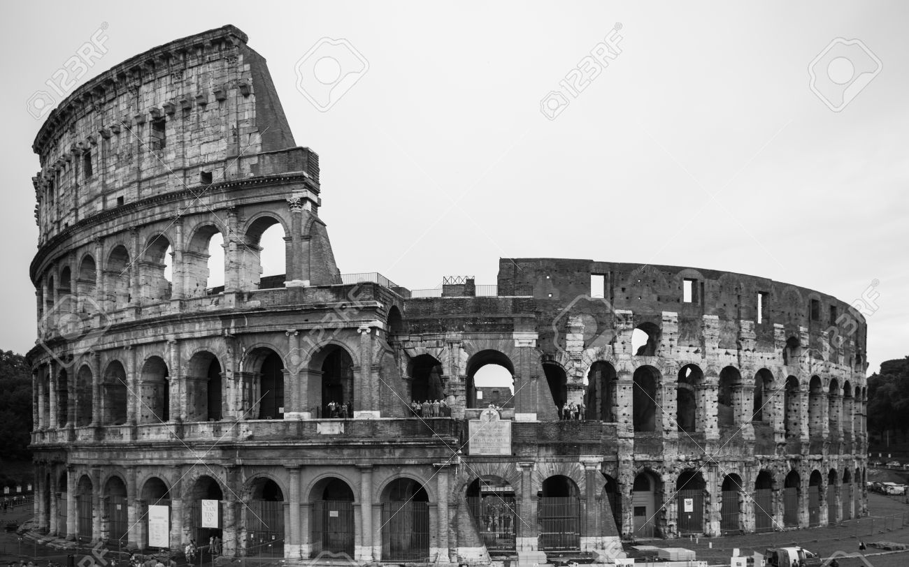 Exterior scene of the ancient colosseum ruin in black and white rome italy stock