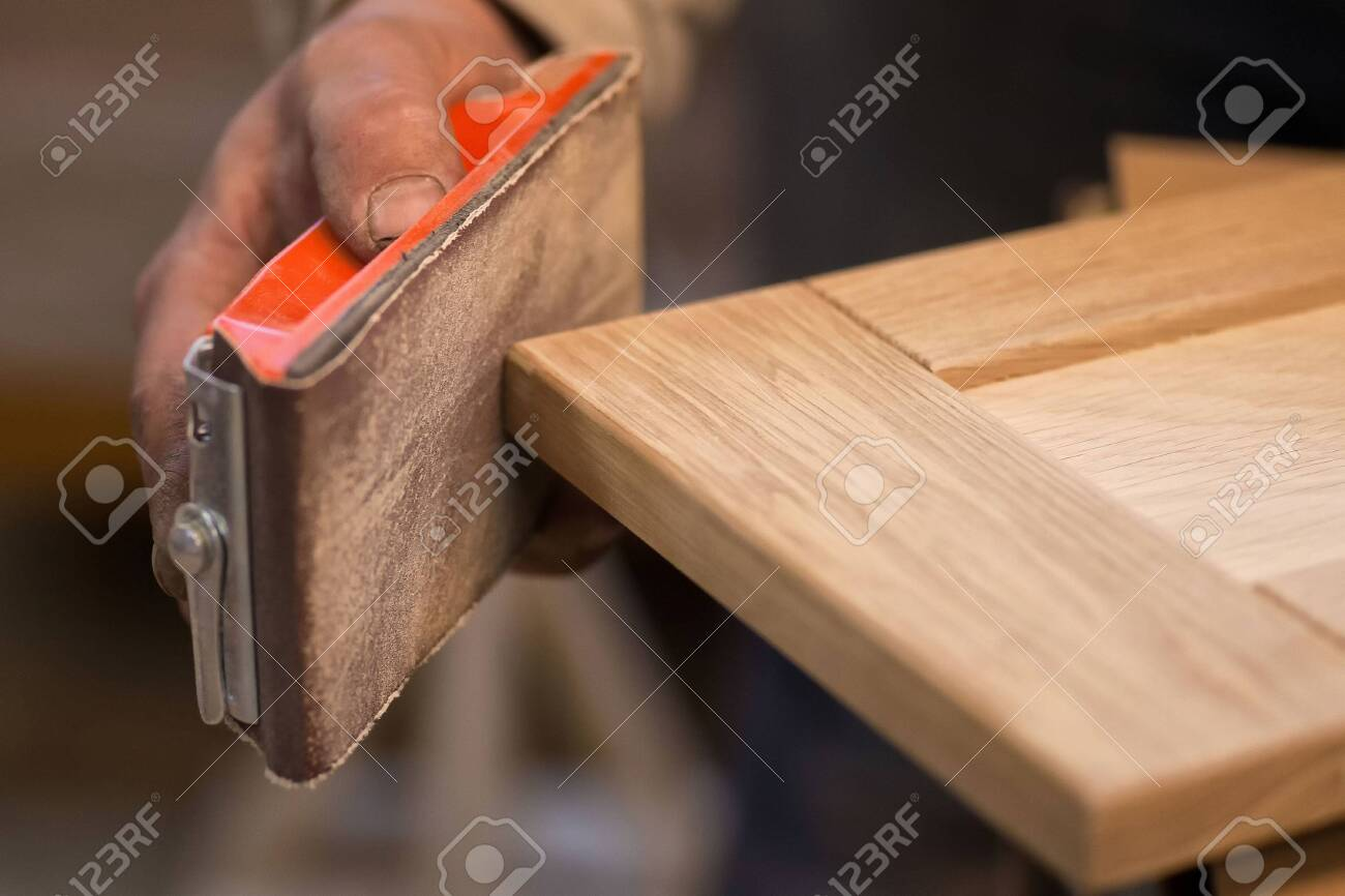 Manual manufacturing of furniture from a natural tree in a workshop. - 127917685