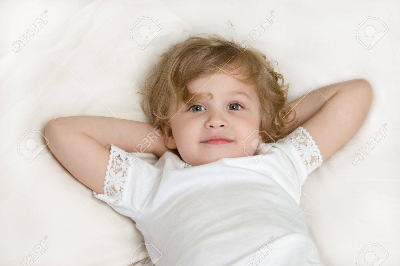 Adorable little girl resting in the bed close-up Stock Photo - 10296128