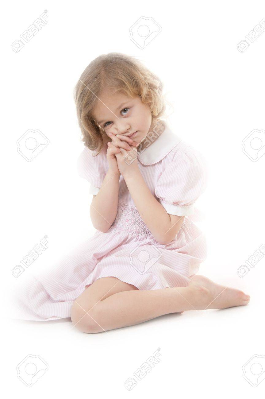 bbd4d40e775d Sad adorable little blonde girl at the age of five wearing a pink dress  sitting pensively