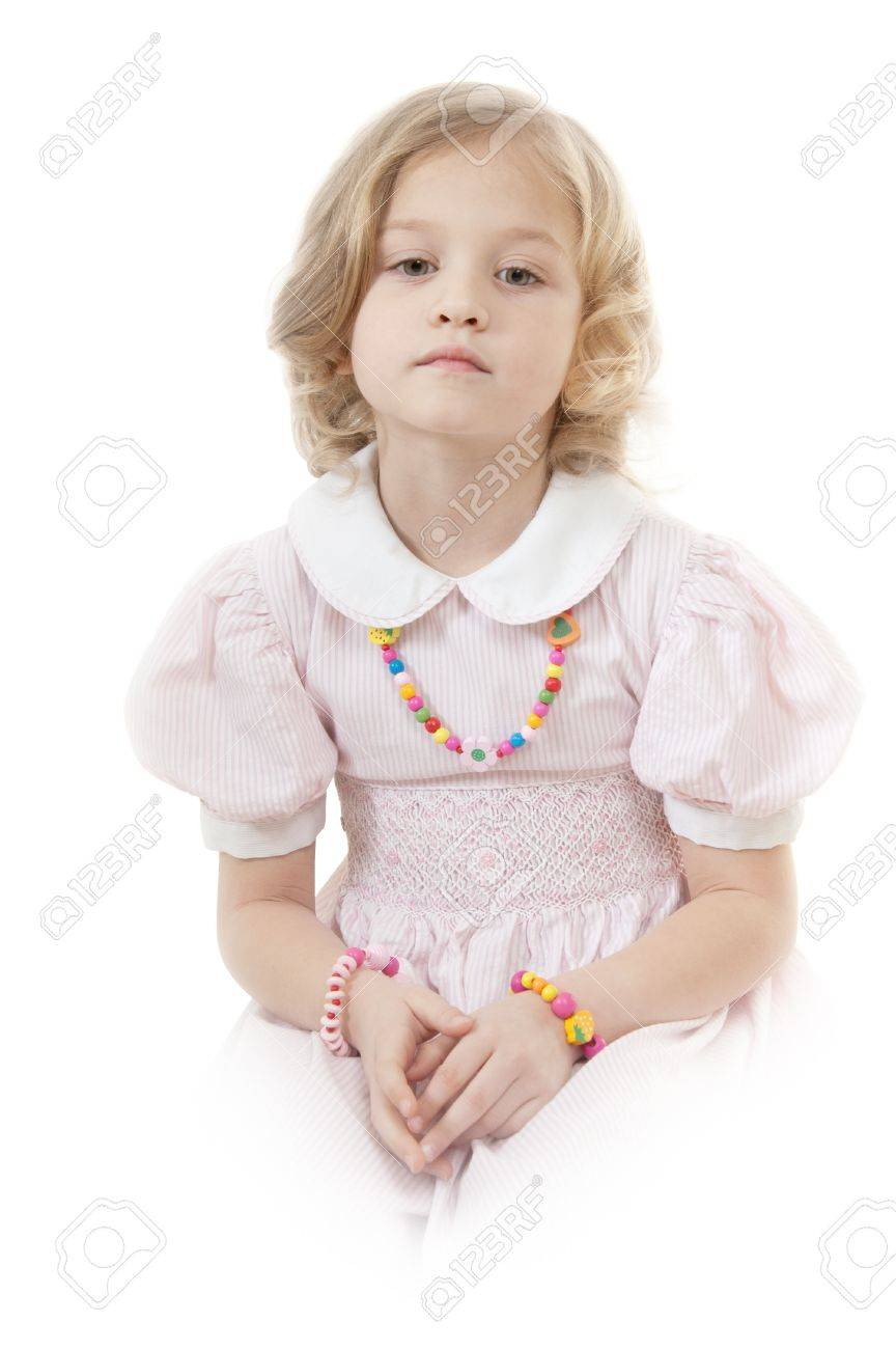 940c19bf90a7 Sad adorable little girl at the age of five wearing a pink dress looking  down thoughtfully