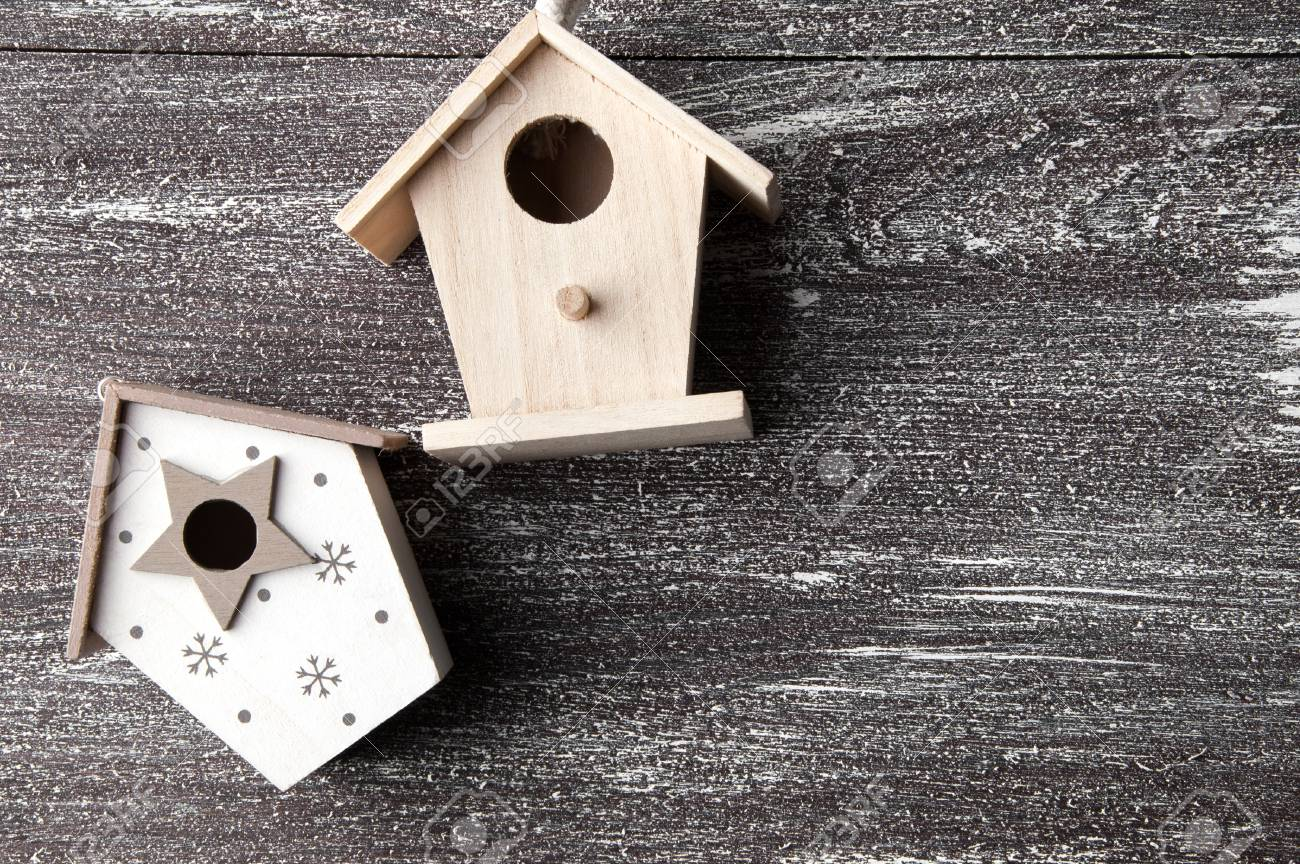 Christmas Birdhouses.Wooden Christmas Birdhouses On Shabby Wooden Brown Background