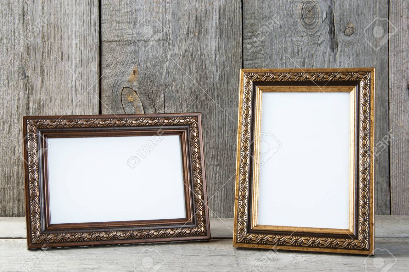 Two Empty Picture Frames On Old Wooden Gray Textured Background