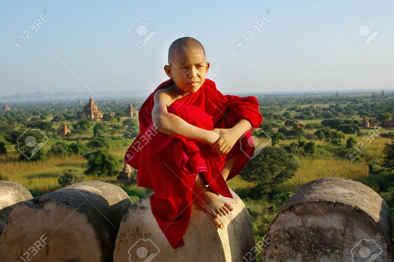 young buddhist monk on temple background Stock Photo - 2450719