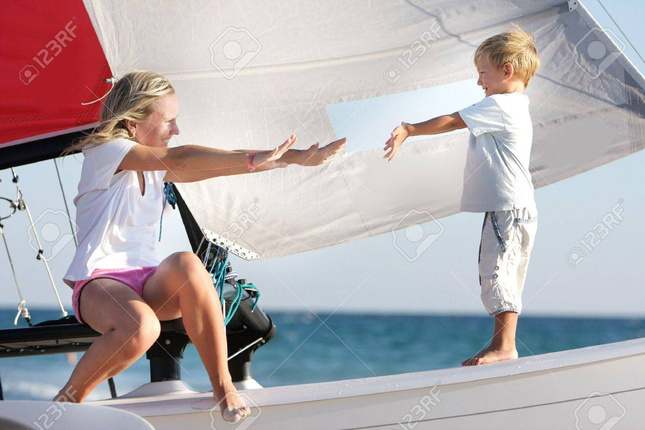 loving mother and son on board of sea yacht Stock Photo - 7791188