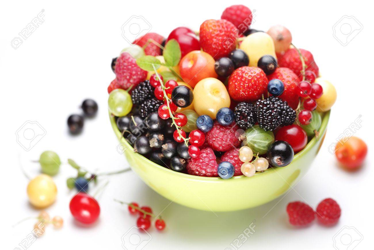 Different colourful berries in the bowl. Closeup front shot. Stock Photo - 7732126