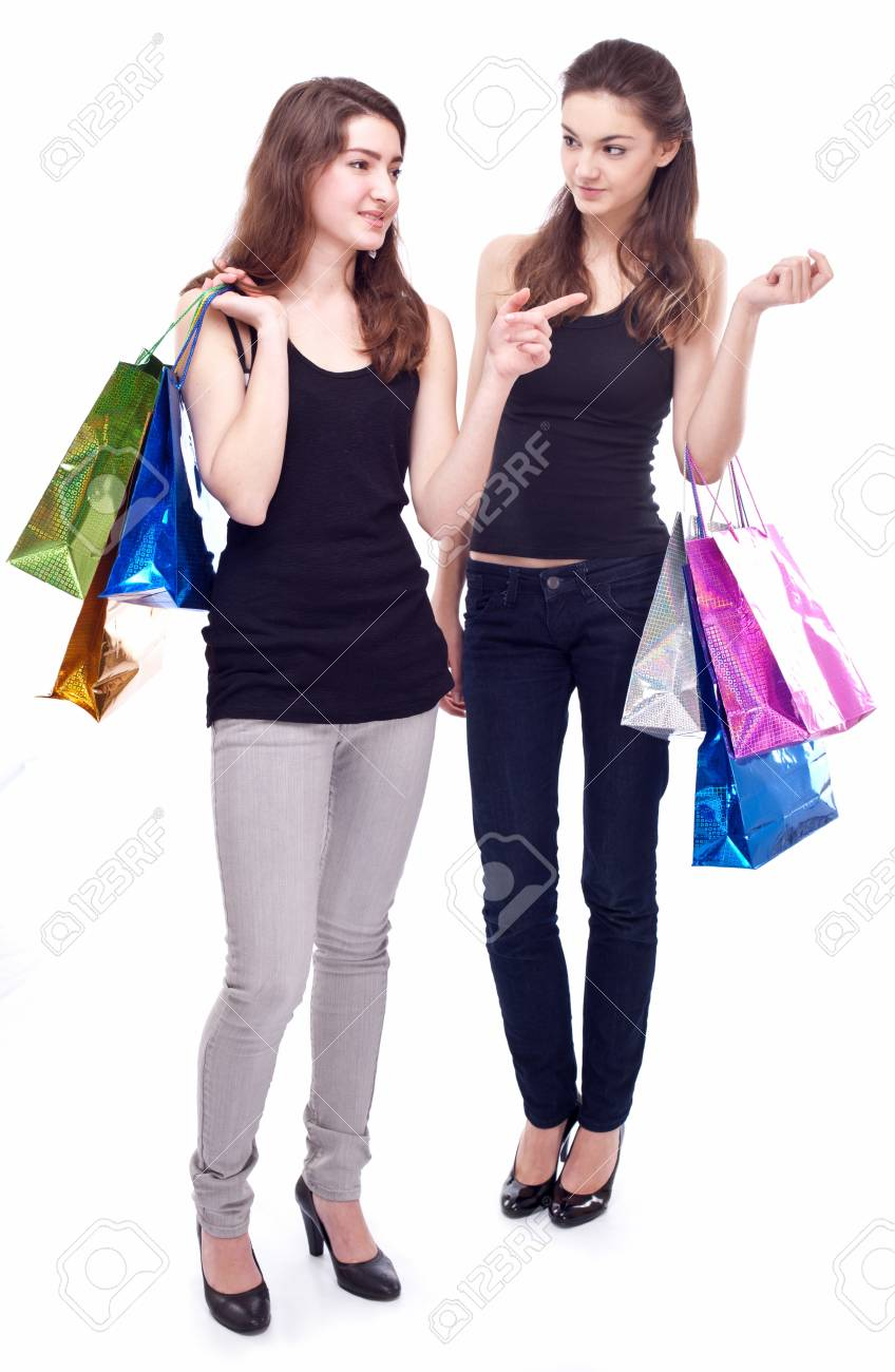 Image of two girls with their purchases. Isolated on white background. Stock Photo - 8718487