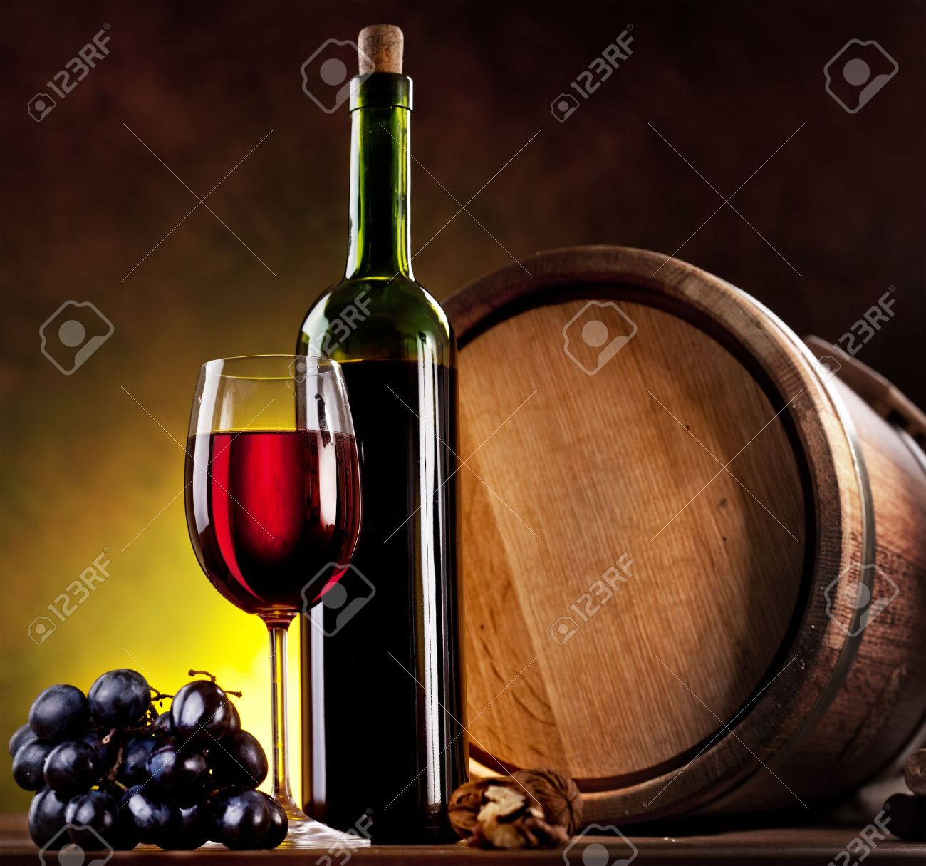 Still life with wine bottle, glass and oak barrels. Stock Photo - 9074392