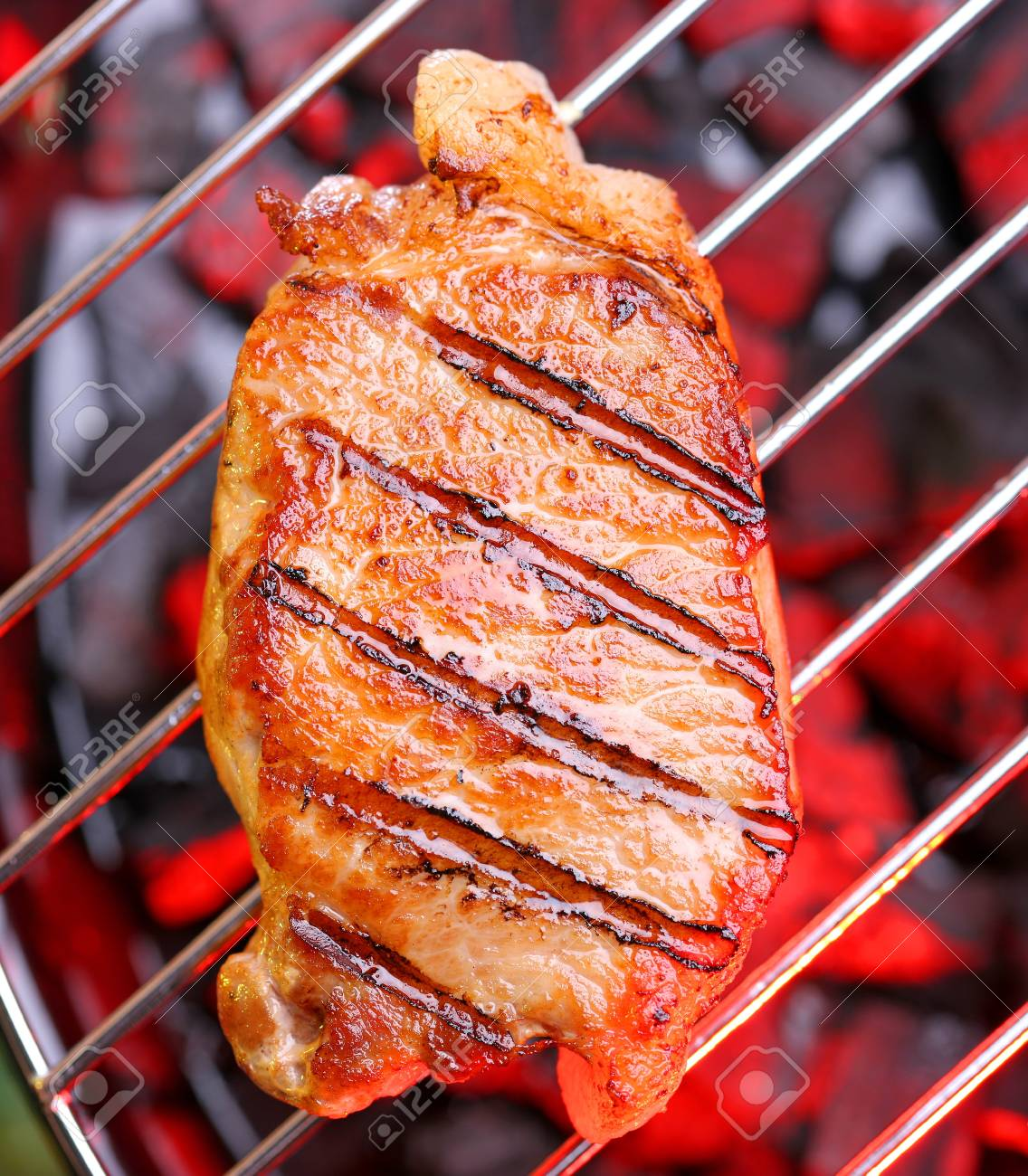 Hot beefsteak on barbecue Stock Photo - 9247968