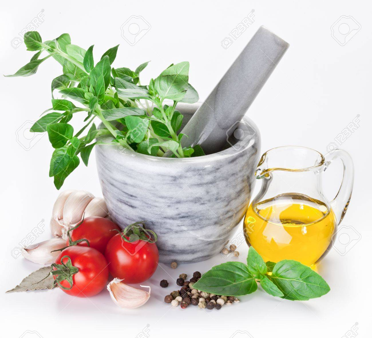 Mortar with pestle and basil herbs and olive oil. - 11373557