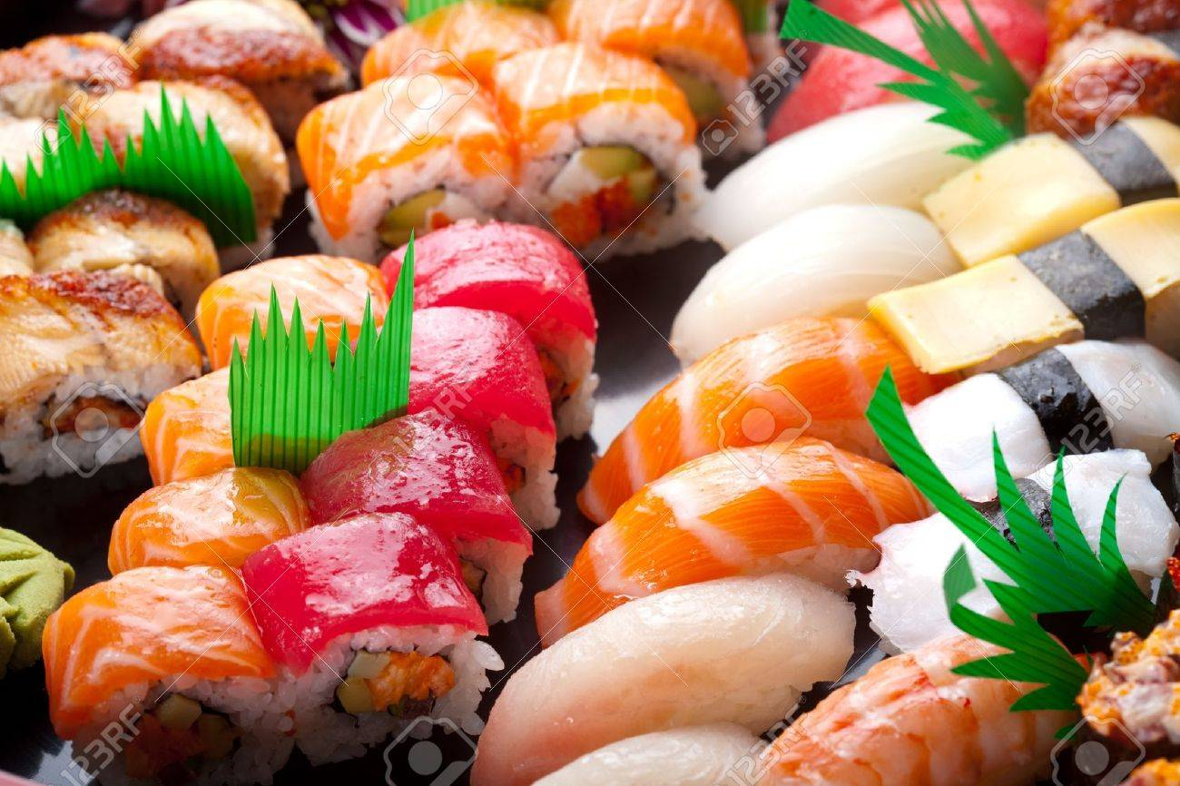 Sushi rolls on a black plate. Stock Photo - 12083693