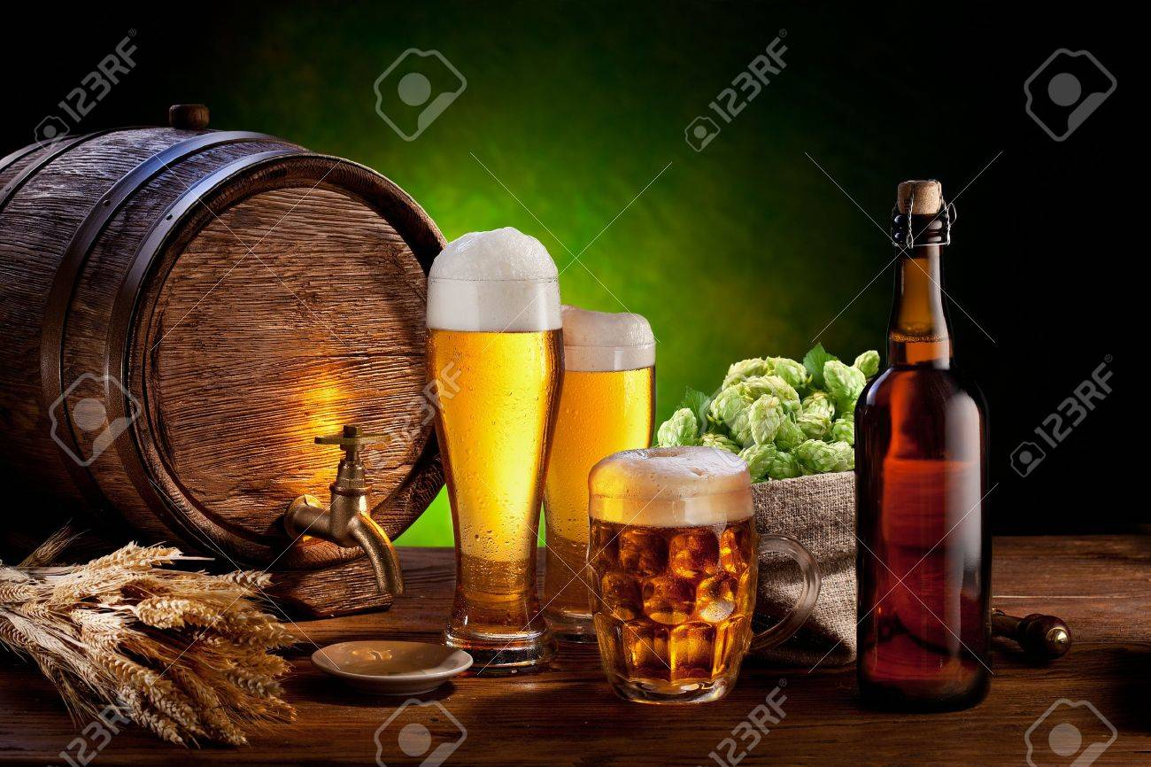 Beer barrel with beer glasses on a wooden table  The dark green background Stock Photo - 14040097