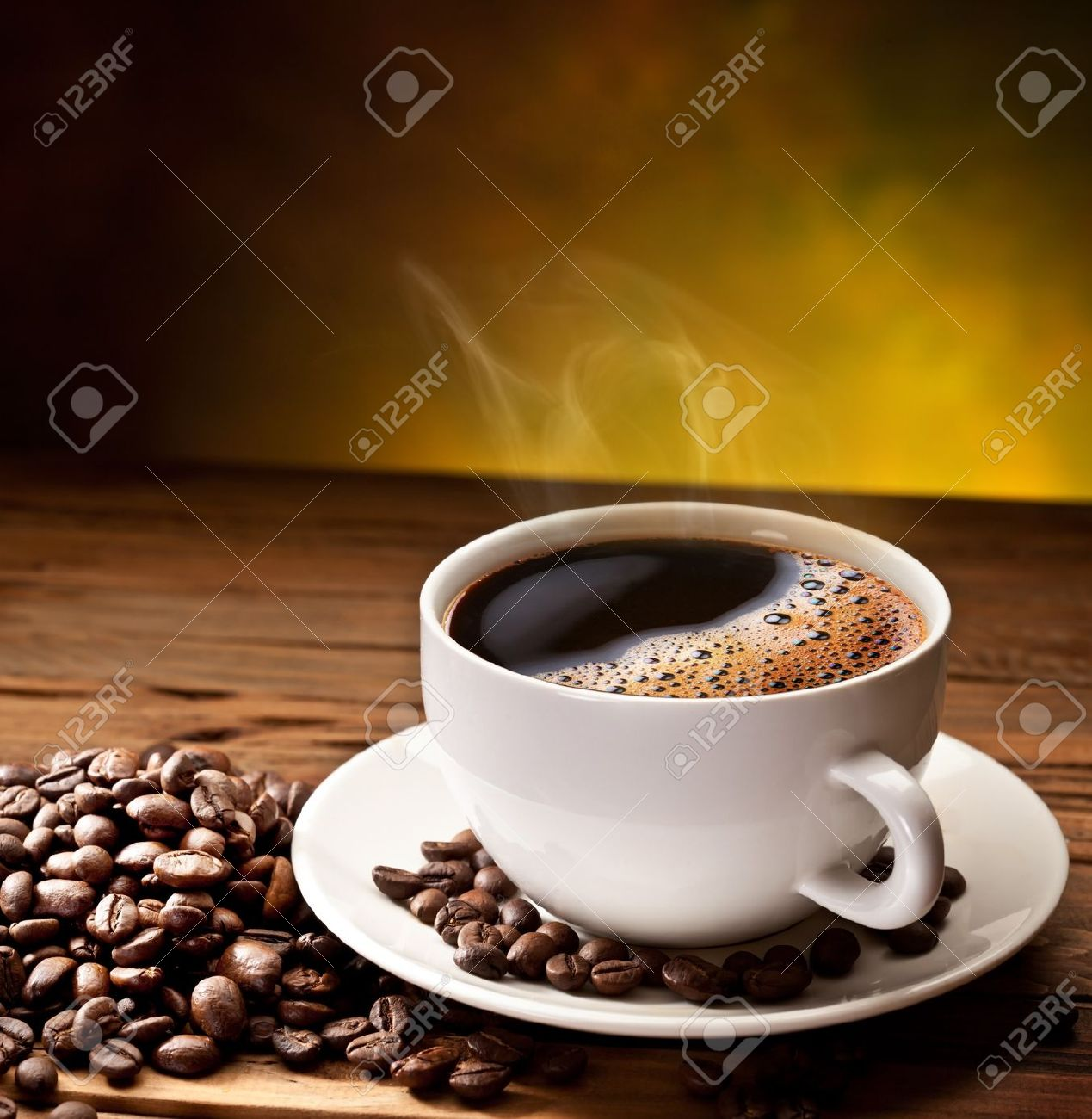 Coffee cup and saucer on a wooden table. Dark background. Stock Photo - 15195673